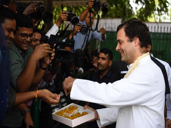 Congress President Rahul Gandhi distributed sweets to journalists at AICC headquarters on his 49th birthday.
