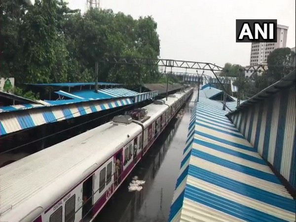 Railway tracks submerge at Sion railway station, after heavy rains in the area.
