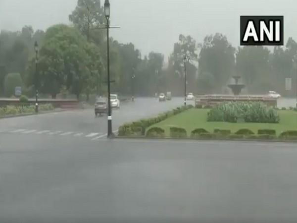 Rain lashes parts of national capital; visuals from Rajpath. (Photo/ANI)