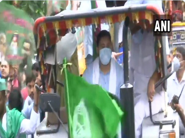RJD leader Tejashwi Yadav drives a tractor, as he takes part in the protest against farm Bills. [Photo/ANI]