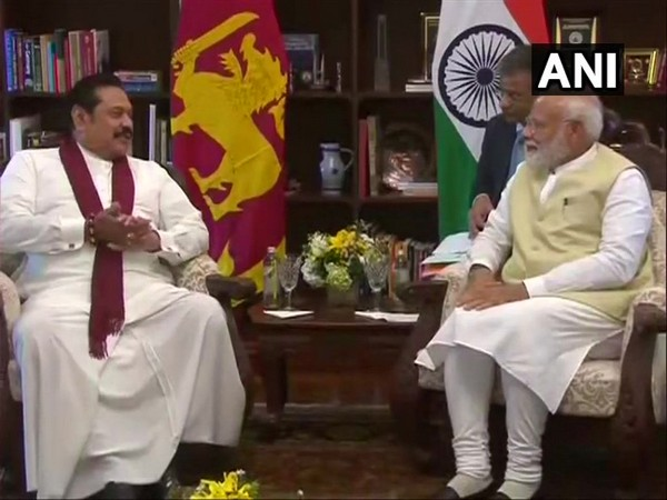Sri Lankan Leader of Opposition, Mahinda Rajapaksa (L), interacts with Prime Minister Narendra Modi in Colombo on Sunday (Photo/ANI)