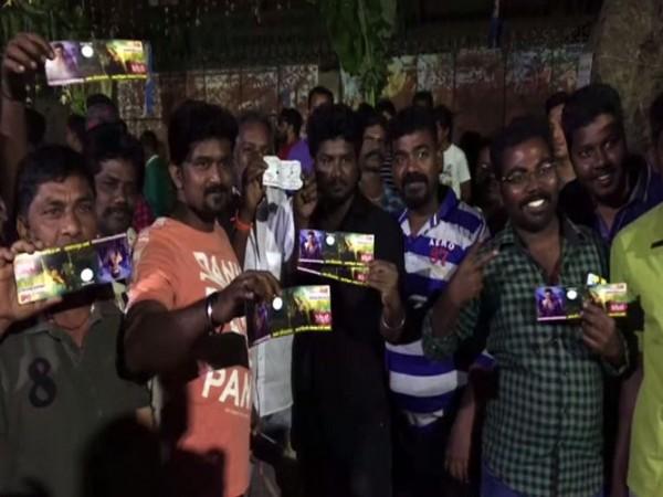 Fans outside movie theatre in Madurai (Photo/ANI)