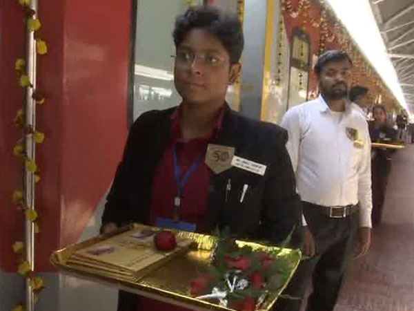 Railway staff at Howrah welcomed Rajdhani passengers with flowers on golden jubilee run of the train on Sunday