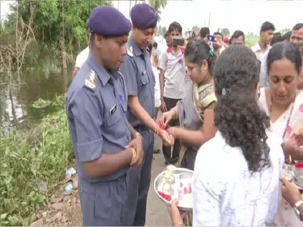 Local villagers tied rakhi to NDRF Jawans for saving them from the floods. Photo/ANI
