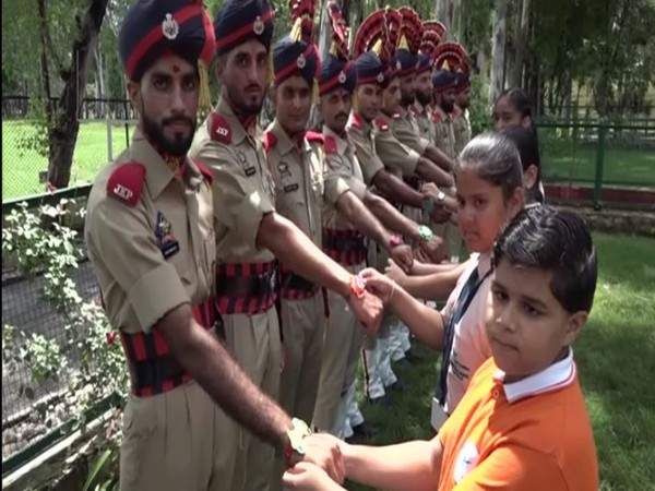 The school girls tied rakhi on the wrists of the security personnel here on Wednesday in Kathua