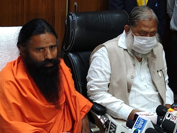 Yoga guru Ramdev (Left) and Haryana Health Minister Anil Vij during a press conference in Chandigarh on Tuesday. (Photo/ANI)