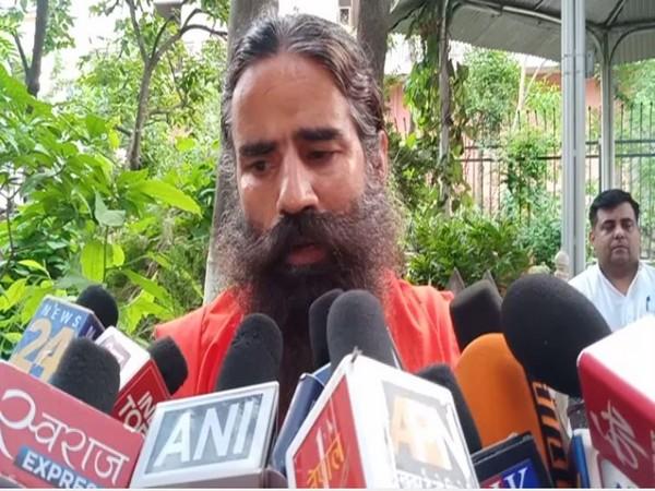Ramdev speaking to reporters in Haridwar, Uttarakhand on Saturday.