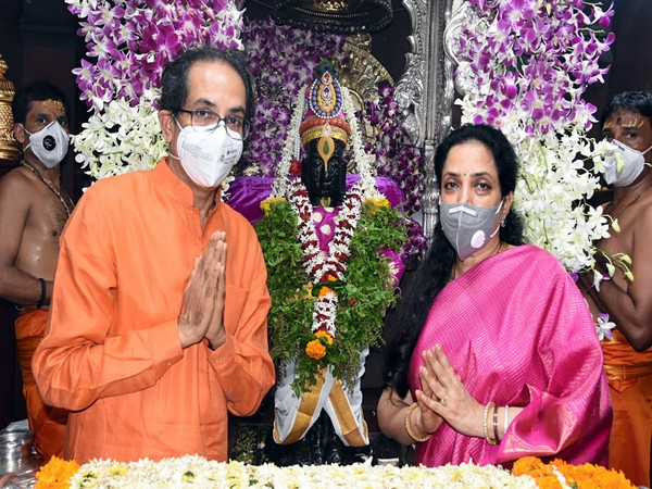 Chief Minister Uddhav Thackeray with his wife Rashmi Lord Vitthal temple in Pandharpur. Photo/ANI