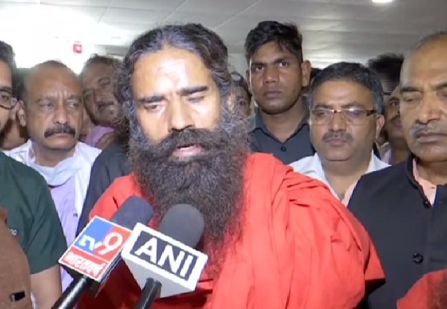 Yoga Guru Baba Ramdev speaking to media at AIIMS, Rishikesh in Uttarakhand on Friday.