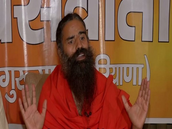 Yog Guru Ramdev addressing a press conference in Gurugram on Thursday. Photo/ANI