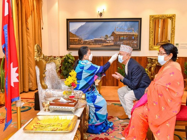 Nepal President Bidhya Devi Bhandari on Monday offered Tika to Prime Minister KP Sharma Oli along with the first lady on Bijaya Dashami. Photo/ANI