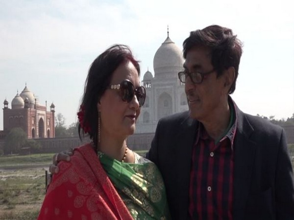 A couple visiting Taj Mahal to celebrate Valentine's Day.