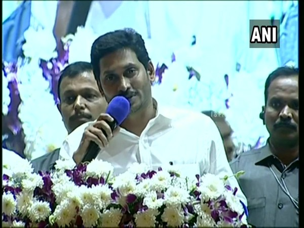 Andhra Pradesh CM Jagan Reddy addressing a gathering at the launch of YSR Post Operative Sustenance scheme in Guntur on Monday. (Photo/ANI)