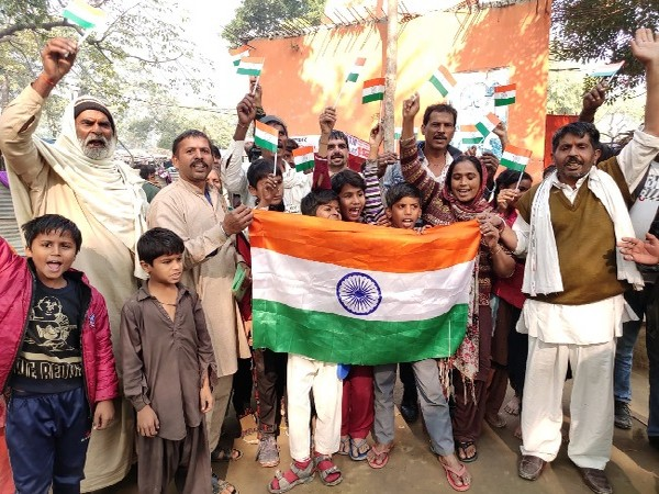 A visual of Pakistani Hindus celebrating in their resettlement colony in Delhi on Tuesday. Photo/ANI