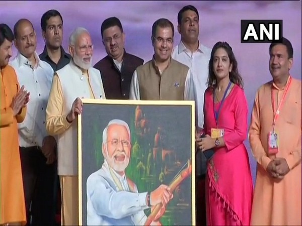 Renuka presented painting to PM Modi at Rameela ground Dwarka, New Delhi on Tuesday