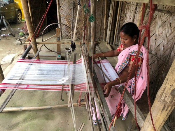 A craftswoman weaving Gamosa in Assam. (ANI)