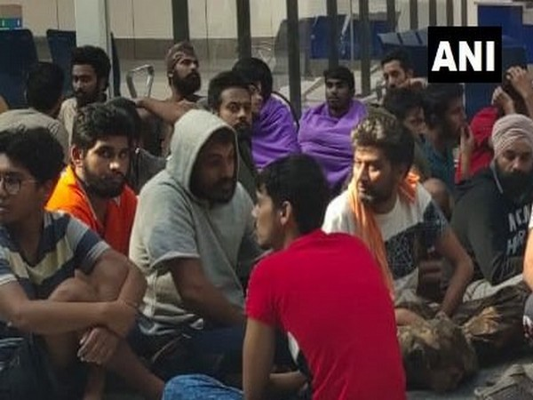 Repatriated Indians gathered outside IGI airport in New Delhi on Friday