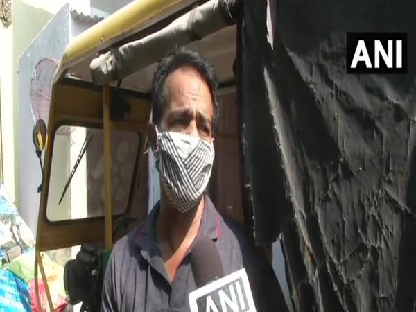 Manoj, e-rickshaw puller, speaking to ANI. Photo/ANI