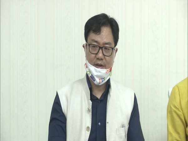 Union Minister Kiren Rijiju speaking to reporters on Sunday.