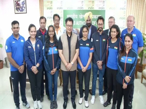 Union Youth Affairs and Sports Minister Kiren Rijiju with the medal winner shooters of the ISSF World Cup