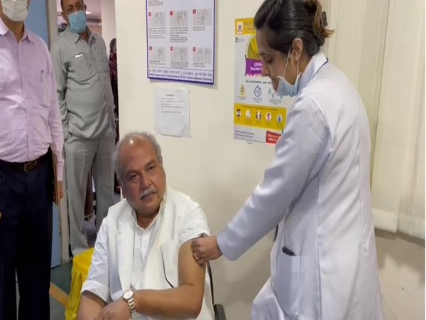Union Minister Narendra Singh Tomar taking his first dose of the COVID19 vaccine.