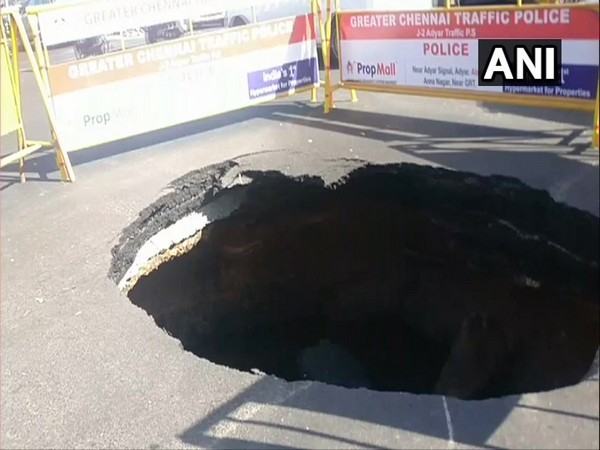 Visuals of the sinkhole appeared on the road at the busy Madhya Kailash junction in Chennai on Thursday. (Photo: ANI)