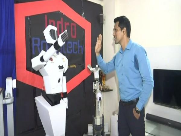 Santosh Hulawale with Service Humanoid Robot. (Photo/ ANI)
