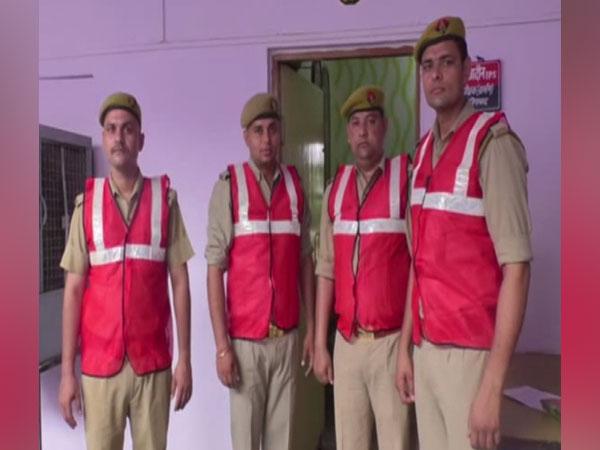 Ghaziabad police anti romeo squad wearing red jackets. Photo/ANI
