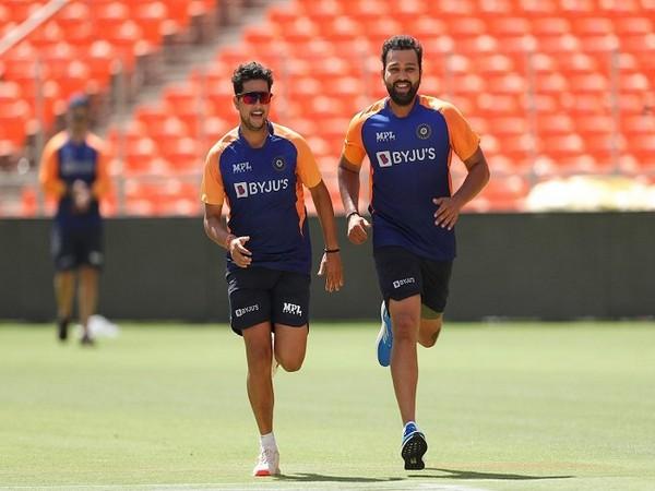 India spinner Kuldeep Yadav and batsman Rohit Sharma (Image: Rohit Sharma's Twitter)
