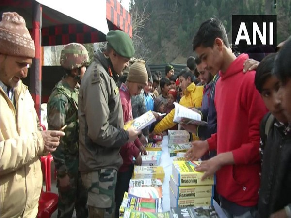 Rashtriya Rifle distributed competitive exam books among students in Poonch on Thursday