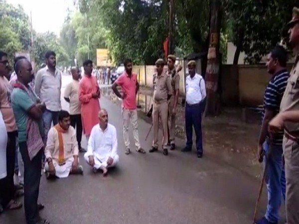 BJP leader Anil Singh sitting on Dharna after accusing police personnel of misbehaviour. (Photo/ANI)