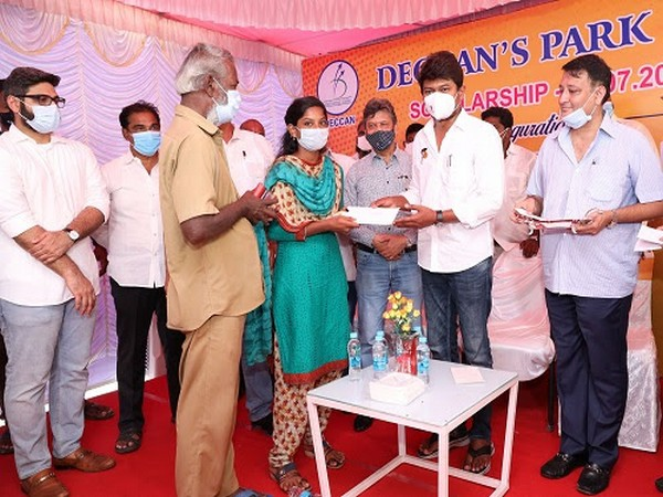 Udhayanidhi Stalin, MLA, hands over Deccan's Park Education Scholarship to a student. Doulat Jain and Nirmal Anraj Gadhiya, directors of Deccan's Park Ltd are also seen in the picture