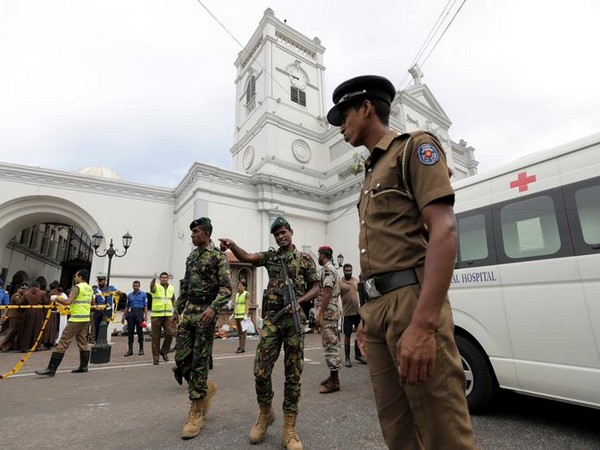 Sri Lankan police guarding a church in Colombo on April 21 in the wake of deadly explosions