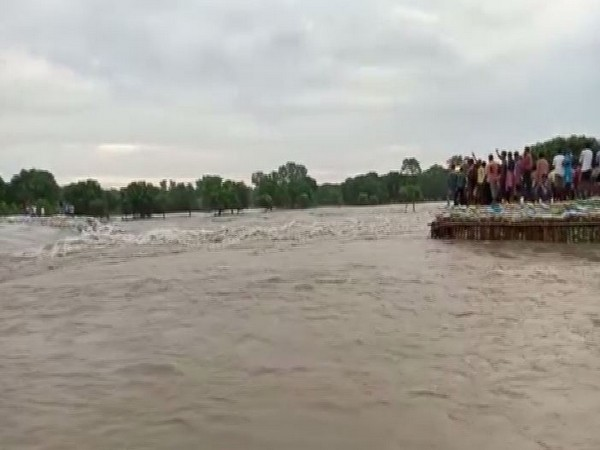 Due to a breakage of the temporary embankment on Fulahar river in Malda in West Bengal on Thursday. Photo/ANI