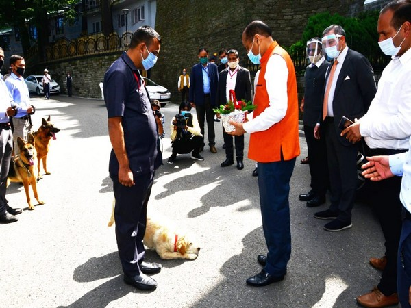 A canine from Himachal Pradesh police's dog squad saluted Chief Minister Jai Ram Thakur and Assembly Speaker Vipin Singh Parmar today. (Photo/ANI)