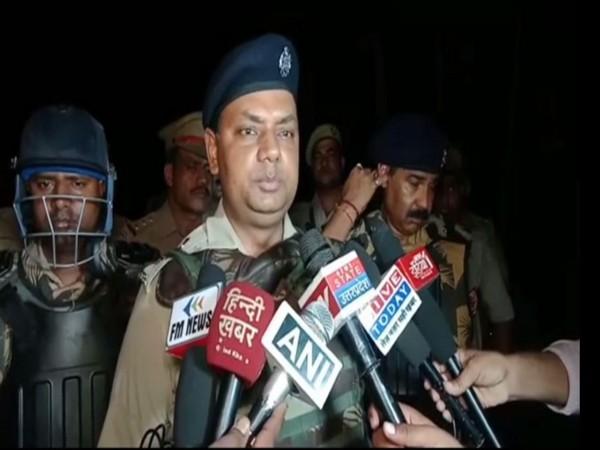 Superintendent of Police, Yamuna Prasad speaking to reporters in Sambal, Uttar Pradesh.
