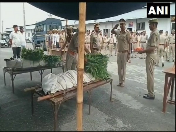 Uttar Pradesh police while paying tribute to two police personnel killed in Sambhal on Thursday. Photo/ANI