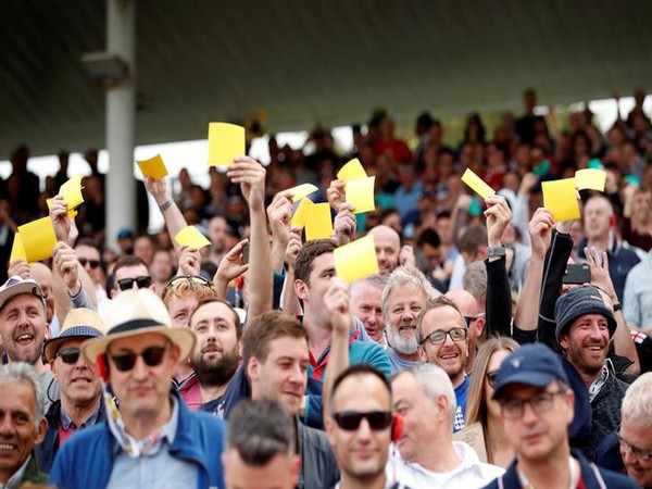 England fans holding up sandpapers on David Warner's dismissal during Ashes 2019