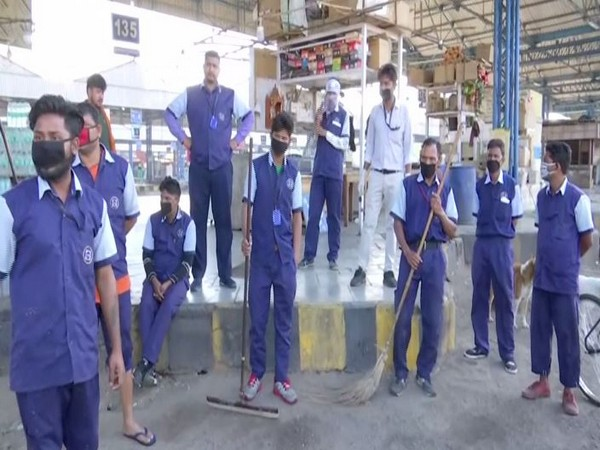 Sanitation workers at Anand Vihar Bus Terminal on Sunday.