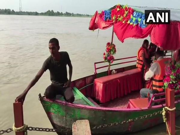 Visitors at Sarayu river wearing life jackets on Wednesday. Photo/ANI