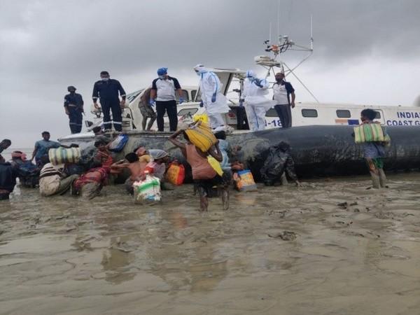 Indian Coast Guard helping locals in Odisha. (Photo/PIB)
