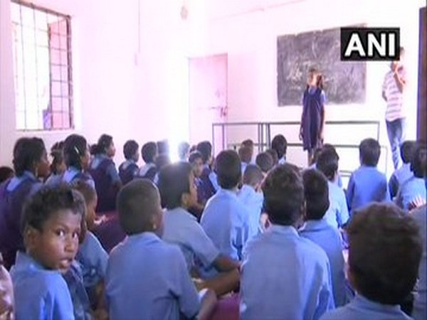 Students while attending a class in Jagargunda village. (Photo/ANI)
