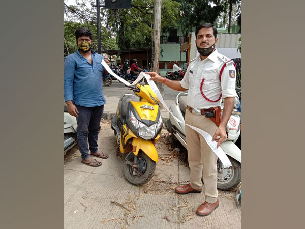 Arun Kumar with his scooter in Bengaluru on Friday. (Photo/ANI)