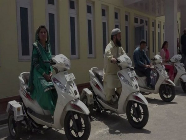 Beneficiaries on specially designed scooters in Doda, Jammu and Kashmir, on Sunday. (ANI/Photo)