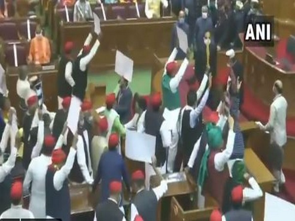 Samajwadi Party MLAs protest against the ruling BJP inside the UP Assembly. (Photo/ANI)