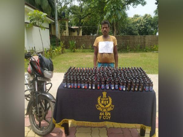 Arrested smuggler with the Phensedyl bottles seized from India-Bangladesh border