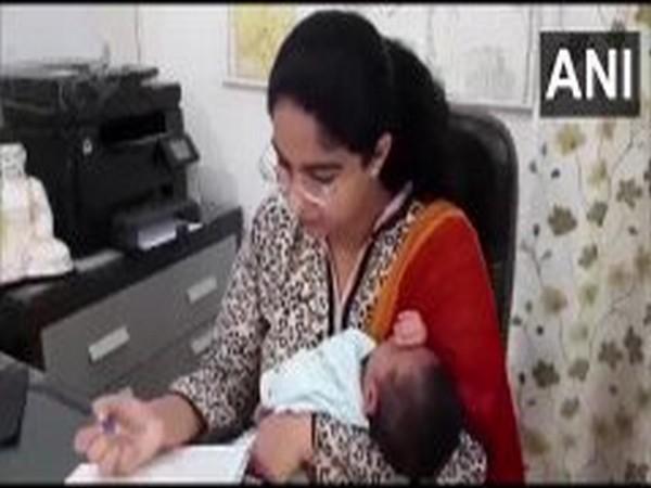 Saumya Pandey, Modinagar sub-divisional magistrate at her office. Photo/ANI