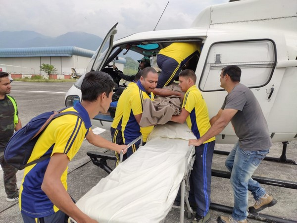 The SDRF team airlifts a man from Kedarnath after he fell ill on Friday. (Photo/ANI)