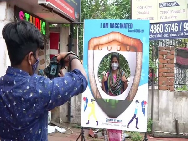 People getting themselves clicked after getting vaccinated against COVID-19. (Photo/ANI)