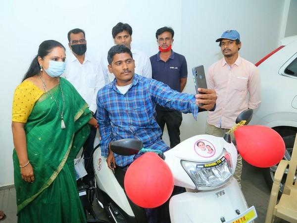 Nizamabad MLC Kalvakuntla Kavitha (left) with the beneficiary and the scooter.